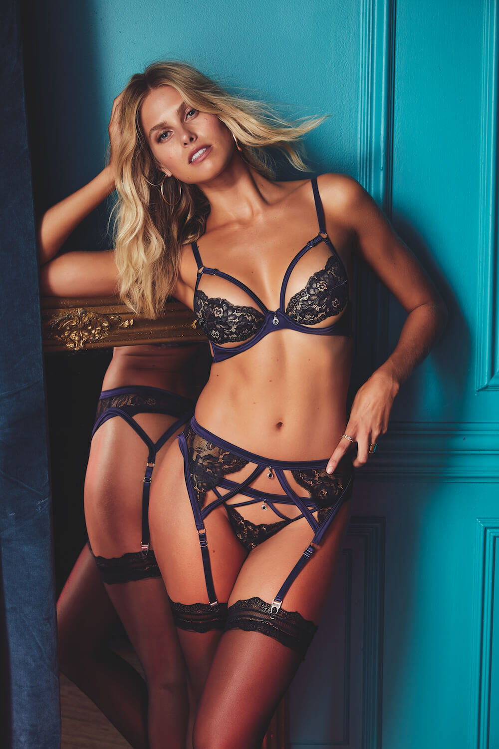 41b594ffd9 Delight in darker tones with the navy satin and black lace of the Myriam Set
